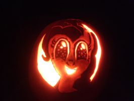 pinkie pumpkin lit up in total darkness by Pwnyville