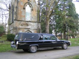 hearse at graveyard by morticiancean