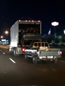 Motorcycles in a truck in a tuck pulling a truck by lunageek520