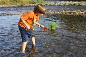 Playing in the River by ArtistStock