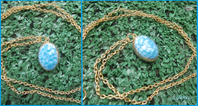 Ice Dragon Egg Necklace With Gold Leaf by Monkiki62