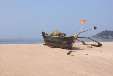 A boat on Vengurla beach by Addy-bose