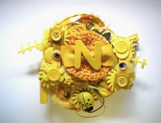 Yellow ''N'' initial brooch by queenofexecutions