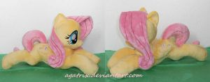 laying down Fluttershy by agatrix