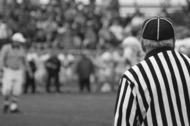 Referee controls the field by RabiorPhoto