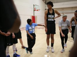 Supertall basketball player and tiny coach by lowerrider