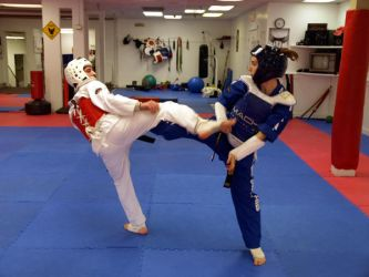 Meggie and Ross Sparring 5 by Kicks02