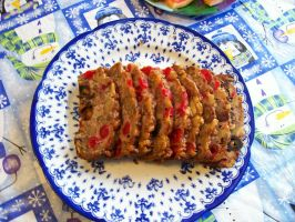 Sliced Fruitcake with cherries dates and walnuts by caspercrafts