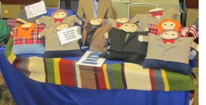 Table of Doctor Who plushies by orinocou