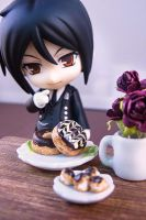 Sebastian and Donuts by nyann
