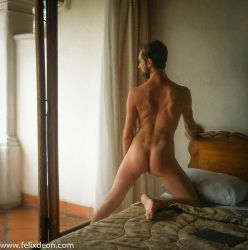 Taxco hotel male nude one leg on bed, back by TheMaleNudeStock