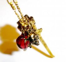 Bloodied Heart charm necklace by PrettyShinyThings