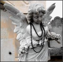 Angel With a Black Mardi Gras Bead by SalemCat
