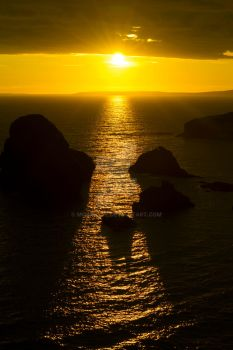 sunset over loop head county clare by morrbyte