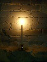 White candle against an old cellar wall by caspercrafts