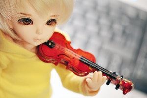 with a violin by Cesia
