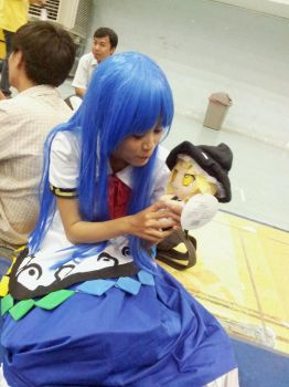 Tenshi plays with doll Marisa by Natsuki-MaiHiME