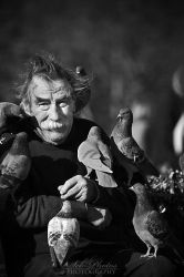 The man who talks to pigeons by Seb-Photos