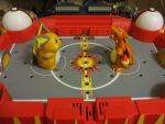 THINKChip: Raichu vs Charizard by Bloodthirstwolf