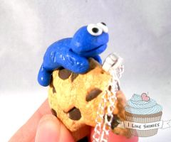 Gimmie the Cookie Monster necklace by ilikeshiniesfakery