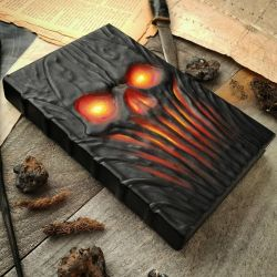 The burning skull's grimoire by MilleCuirs