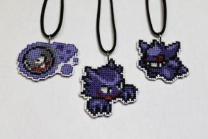 Gastly, Haunter, and Gengar stitched necklaces