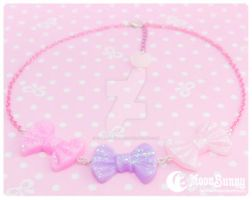 Sparkly rainbow bows Necklace by CuteMoonbunny