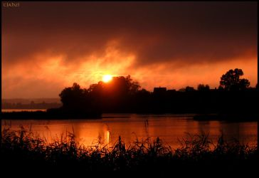 Sunset over a lake 4 by Tjahzi