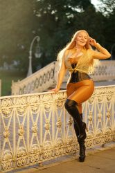 Cute Smiling Blonde Wearing Golden Latex by modelvaahtokaramelli