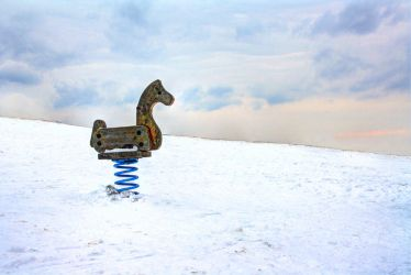 Playground horse in the winter by Anethcom