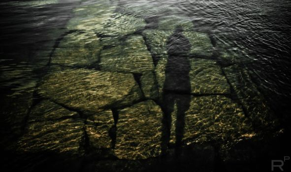 Stone That Lies Beneath The Waves Traps My Shadow by RizzoPhotos
