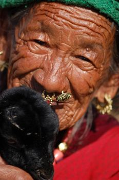 Old Woman with Baby Goat by LeahPhotography