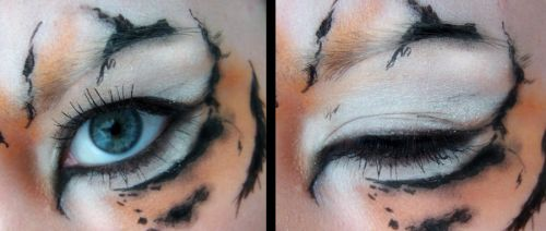 Tiger's eyes by Misty-AnGel