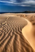 Dunes and lighthouse by MarcioCabral