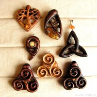 Triskelion triquetra wooden pendants with amber by AmberSculpture