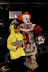 Pennywise and Georgie Cosplay by CosplayQuest