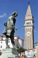Statue and church - Piran by wildplaces