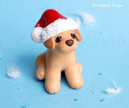 Labrador puppy in a Santa hat by SculptedPups