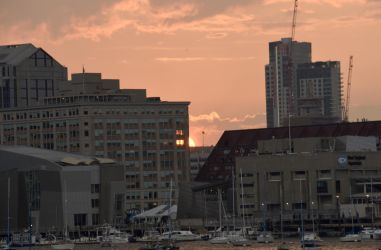 Setting Sun In the Boston Harbor by Miss-Tbones