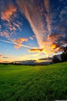 Illuminated clouds at sunset by JoInnovate