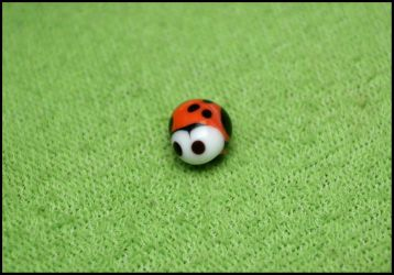 glass bead : ladybug by AnirBrokenear