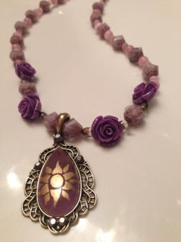 Rupunzel Inspired Necklace by AtomicColor