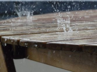 Rain on the wood table by sonique6784