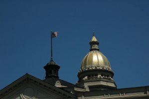Flag set against the capitol by Philzang