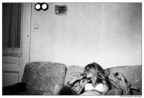 Lady on the couch by Staged