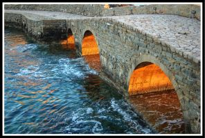 Sunset through the arches by StamatisGR