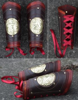 Metal Triskele Bracers by Archanejil