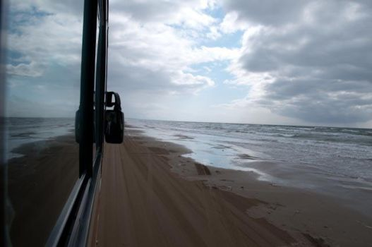 Sea reflection ponder the road by Rnomad