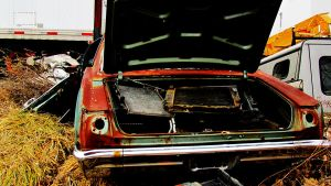 Rusty car with open trunk by jeromy-huber