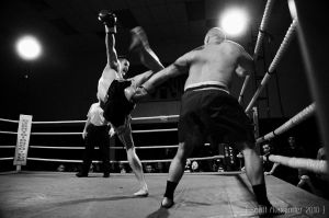 Kick to the head.. by straightfromcamera